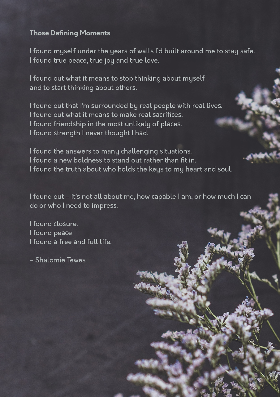 poem on a dark background with mauve flowers