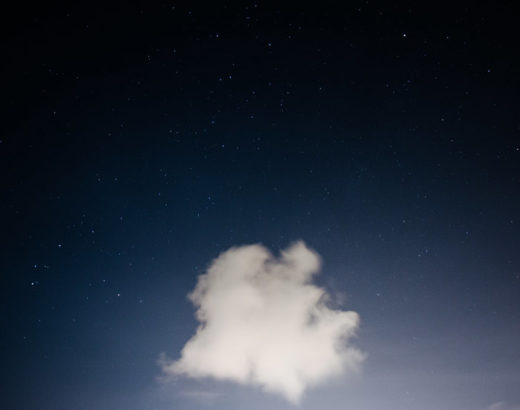 Single cloud against a dark sky