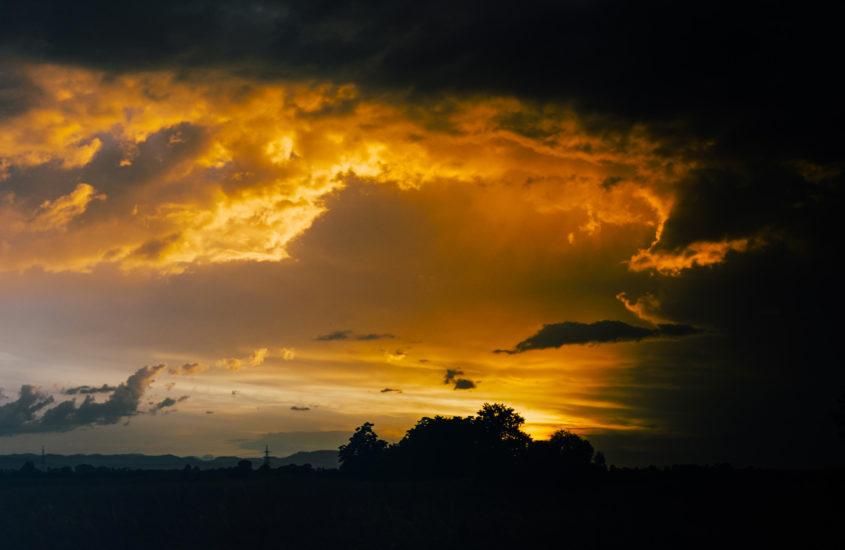 orange clouds in a black sky